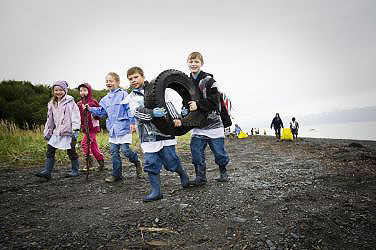 Youth clean debris from Kachemak Bay beaches.
